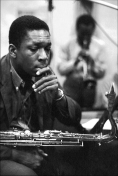 John Coltrane (foreground) and Miles Davis (background) during the recording sessions for Kind of Blue, 1959.
