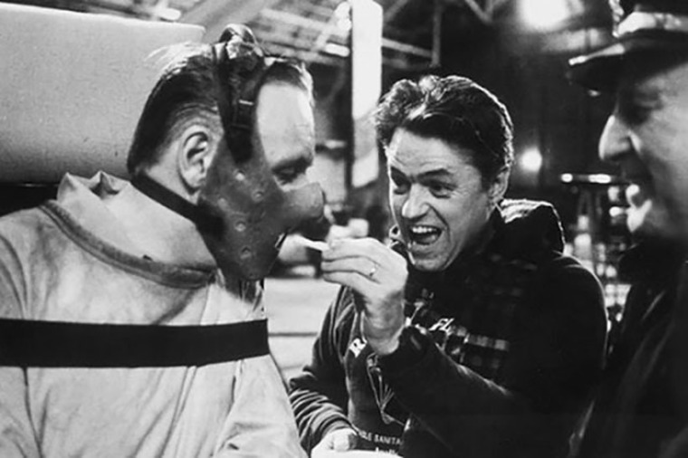 Filmmaker Jonathan Demme feeds Anthony Hopkins as Hannibal Lecter on the set of The Silence of the Lambs.