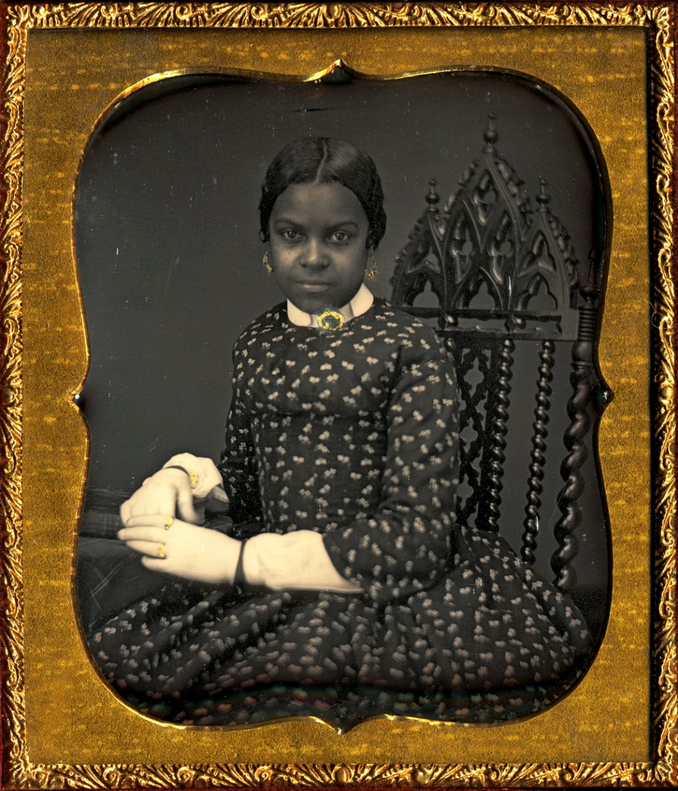 Unidentified maker. [African American woman wearing white gloves], ca. 1855. Daguerreotype with applied color. George Eastman Museum, gift of Eaton Lothrop. Courtesy of the George Eastman Museum